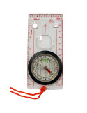Transparent compass with magnifying glass